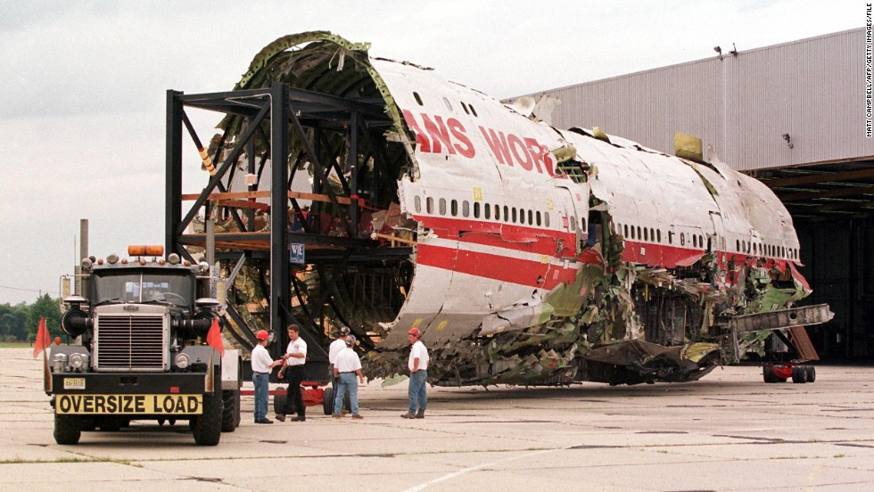 The partially reconstructed fuselage of TWA Flight 800 is pulled out of a hangar in Calverton, New York, on September 14, 1999.