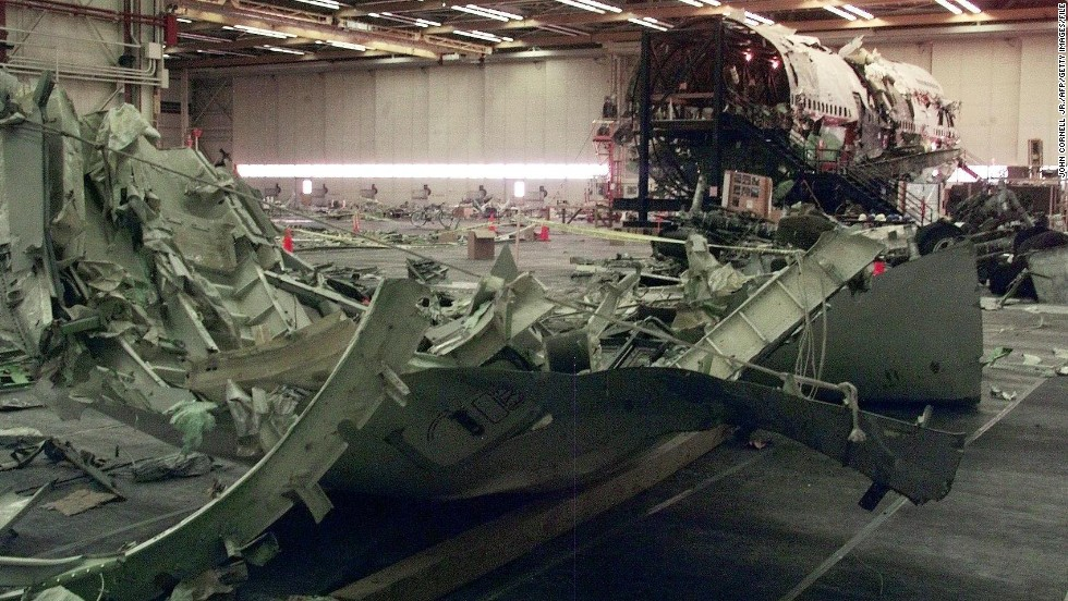 Parts of the aircraft's wing sit in the hangar on July 8, 1999, in Calverton, New York.