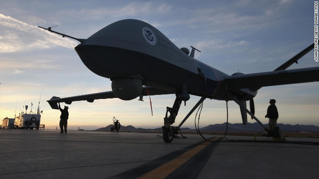 Maintenence personel check a Predator drone operated by U.S. Office of Air and Marine (OAM) before its surveillance flight.