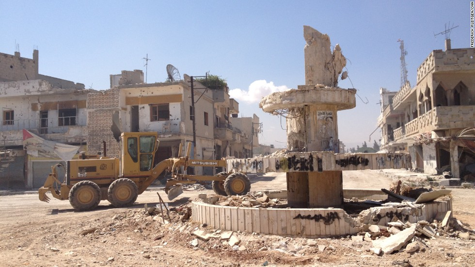 Some heavier equipment is used in clean up efforts in a central square.