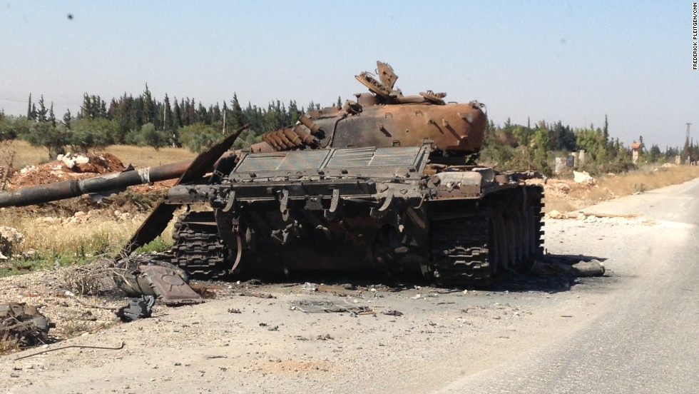 A destroyed tank is pictured at the entrance to the city.
