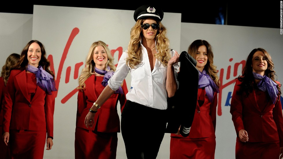 Juli Grbac, the first winner of Project Runway Australia, harked back to the '60s for inspiration when crafting the new uniforms for Virgin Blue. Elle Macpherson modeled the outfits when they were unveiled in 2011.