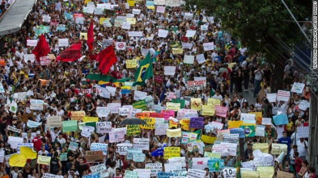 Brazilians march despite fare reversal