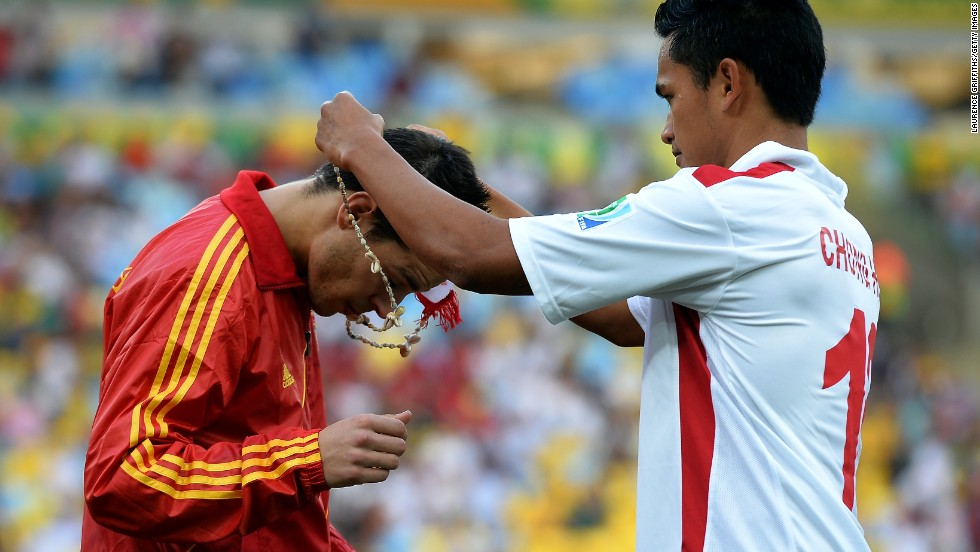Before the game Tahiti's players presented each man in the Spanish squad with a necklace. Here, Steevy Chong Hue puts one round the neck of Cesar Azpilicueta.