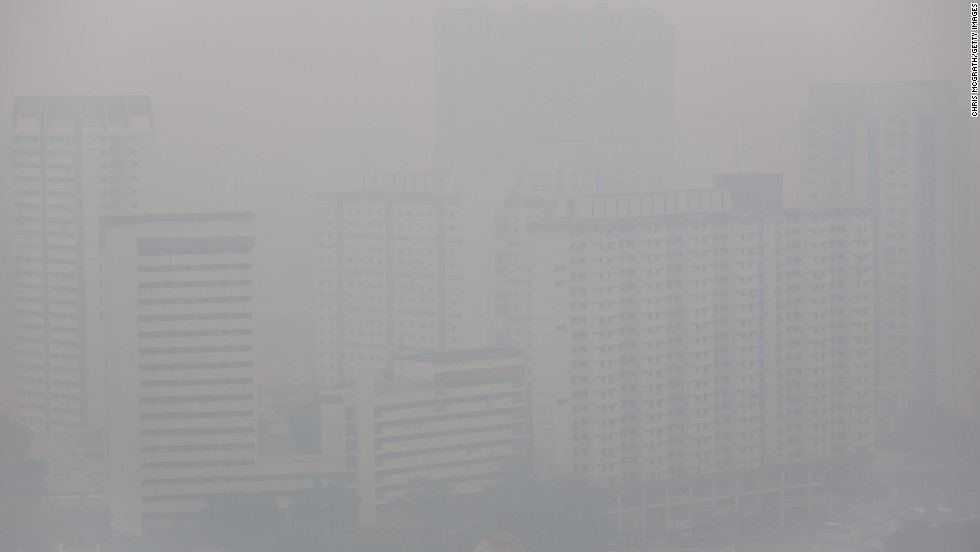 Apartment buildings were shrouded in a haze of smoke on Wednesday, June 19, in Singapore.  The city-state's worst pollution crisis in more than a decade, the haze stems from illegal slash-and-burn forest fires in neighbouring Sumatra, Indonesia.