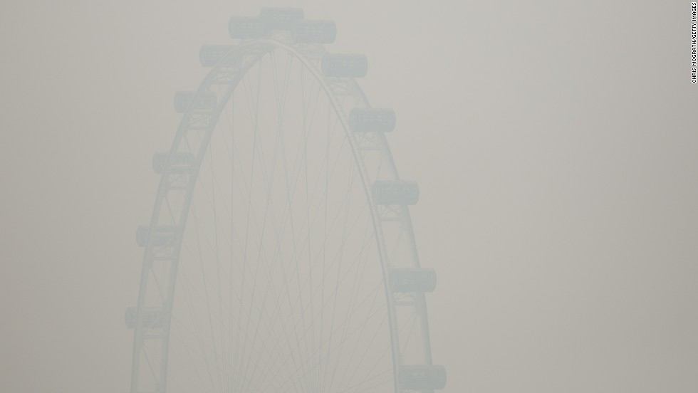 The Singapore Flyer ferris wheel was barely visible through the smoke haze on June 20.  That day, the country's Pollutant Standards Index (PSI) rose to the highest level on record, reaching 371.