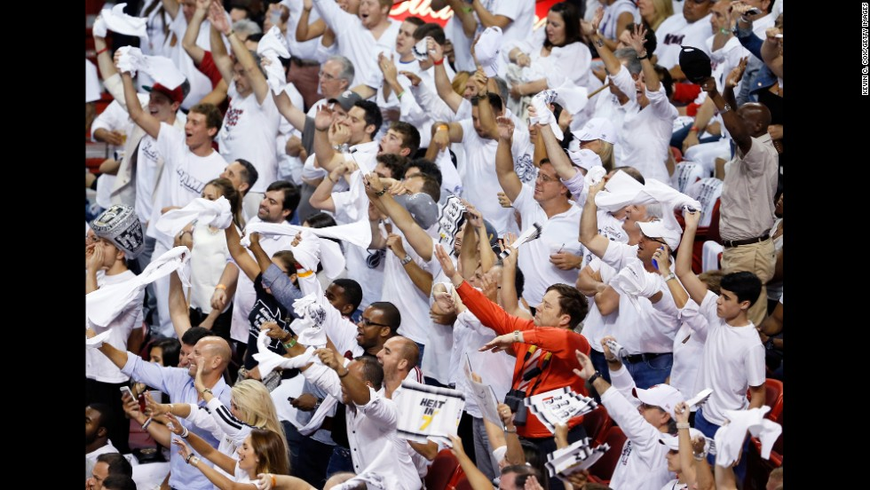 Miami Heat fans cheer in the first half.