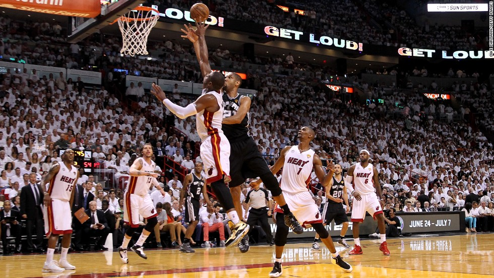 Tim Duncan of the San Antonio Spurs shoots the ball over Dwyane Wade of the Miami Heat in the third quarter.