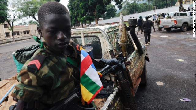 A child soldier in the Central African Republic sits on a truck near the Presidential palace in Bangui on March 25, 2013.