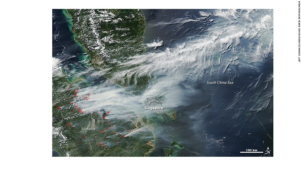 NASA's Terra and Aqua satellites capture images of smoke billowing from wildfires on Sumatra toward Singapore on June 19.