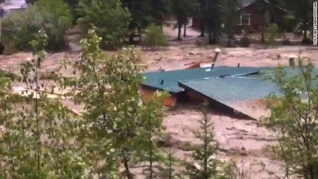 Watch a home float down a river