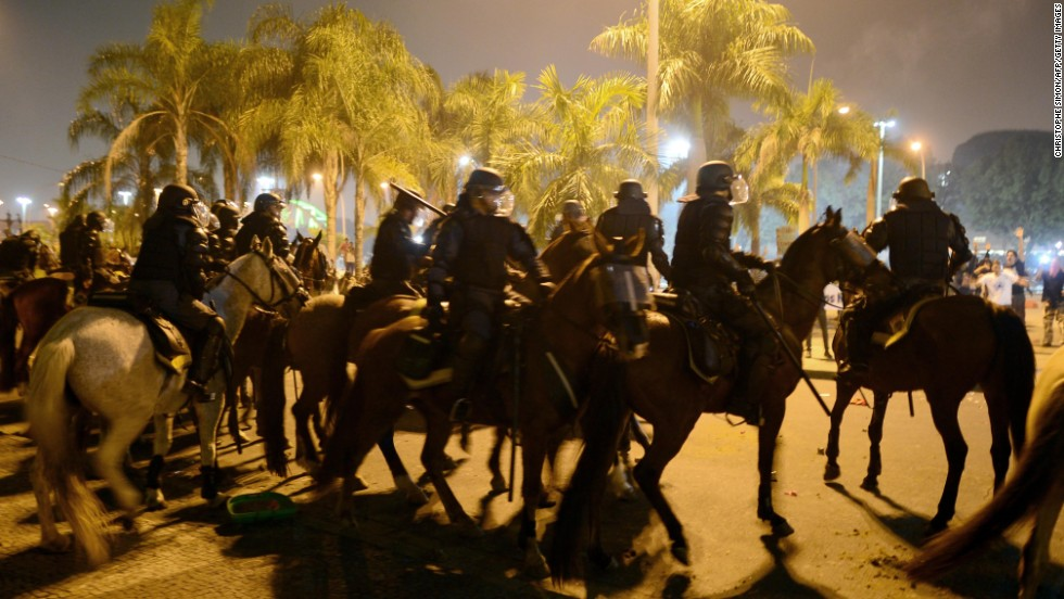 Horse-mounted riot police confront demonstrators in Rio de Janeiro on June 20.