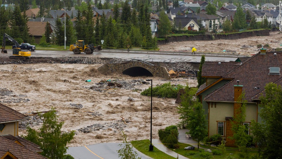 Cougar Creek washes out roads in Canmore on June 20.