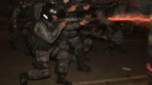 brazil protests tear gas running police_00011323.jpg