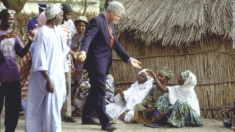 President Clinton greets people during a tour of a village in Senegal on April 1, 1998.