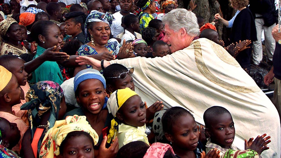 President Bill Clinton reaches out to shake hands while touring Ushafa, Nigeria, on August 27, 2000.