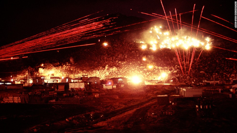 The red lines in the photos are tracer fire from M60 and M2 machine guns. The white areas were created by Browning Machine Guns firing in long bursts.