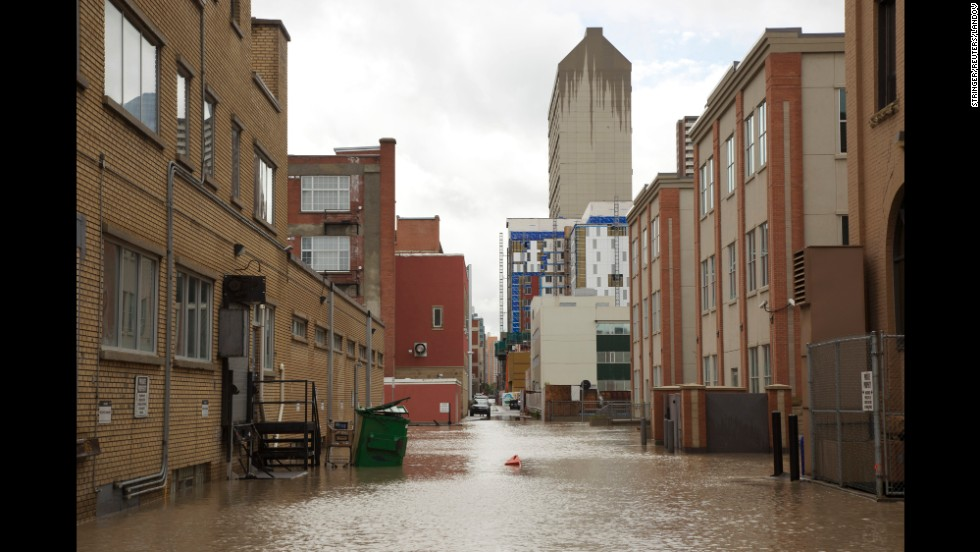 Streets in downtown Calgary are empty except for water after the area was evacuated.