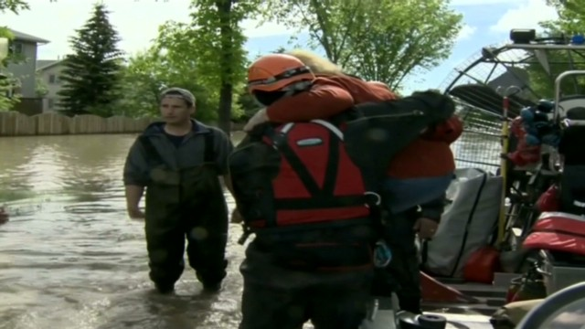 Calgary flooding victims being rescued
