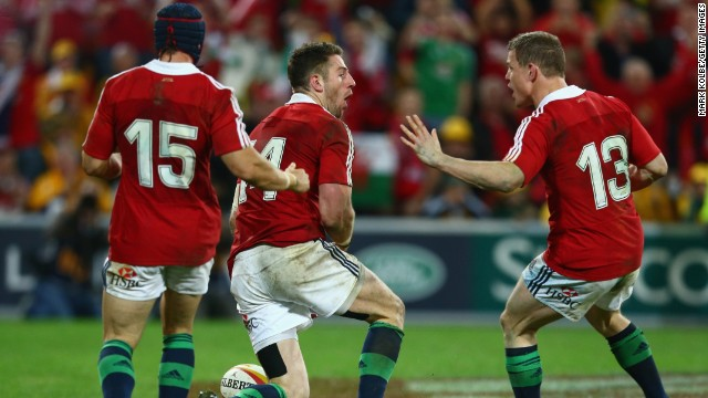Leigh Halfpenny, try scorer Alex Cuthbert and Brian O'Driscoll celebrate the decisive score in Brisbane.
