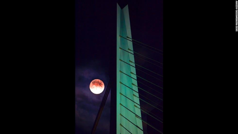 "The moon hangs in the sky over Rotterdam, the Netherlands, on June 22. <a href=""http://ireport.cnn.com/topics/993442"">Share your Supermoon stories.</a>"