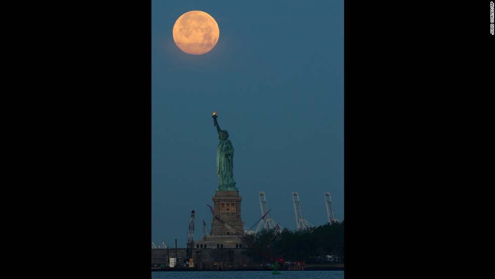 The Supermoon is seen over the Statue of Liberty on June 23 in New York.