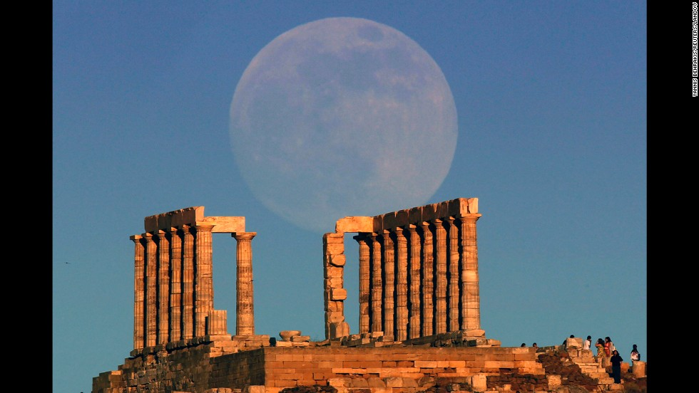 The Supermoon rises over the temple of Poseidon, the ancient Greek god of the seas, as the sun sets on Cape Sounion outside Athens, Greece, on June 22.