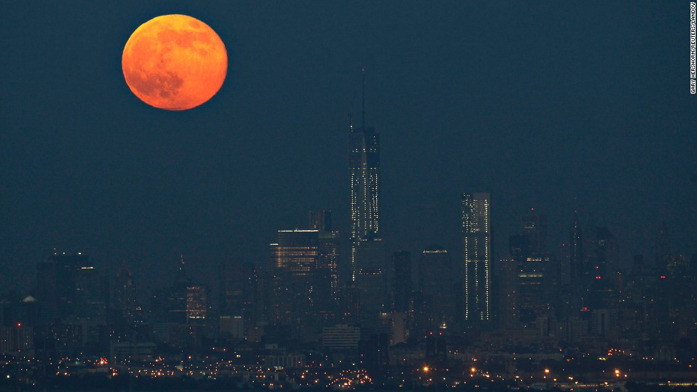 The moon hangs over the Manhattan skyline on June 23.