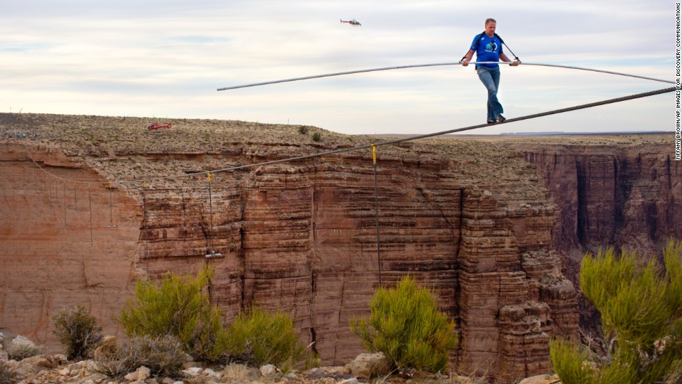 "Nik Wallenda, 34, nears the completion of his<a href=""http://www.cnn.com/2013/06/24/us/arizona-high-wire-wallenda/index.html""> quarter-mile walk near the Grand Canyon</a> on Sunday, June 23, in Arizona. He crossed the Little Colorado River Gorge without the aid of a safety tether. He is a member of the famous Flying Wallendas, founded by his great-grandfather Karl in the 1920s, and also walked across Niagara Falls last year."