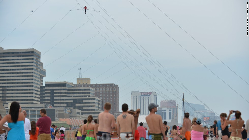 Crowds watch the daredevil during a 1,500-foot tightrope walk 100 feet above the beach in Atlantic City, New Jersey, in August 2012.
