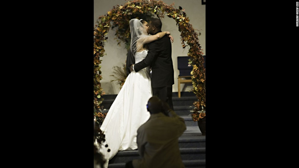 "When guests plant themselves right in front of the couple, there's only so much a photographer can do to get around them, Balazowich said. She was able to go to the sides to crop him out of most pictures but for the kiss, but ""the center shot is the one people want,"" she said."