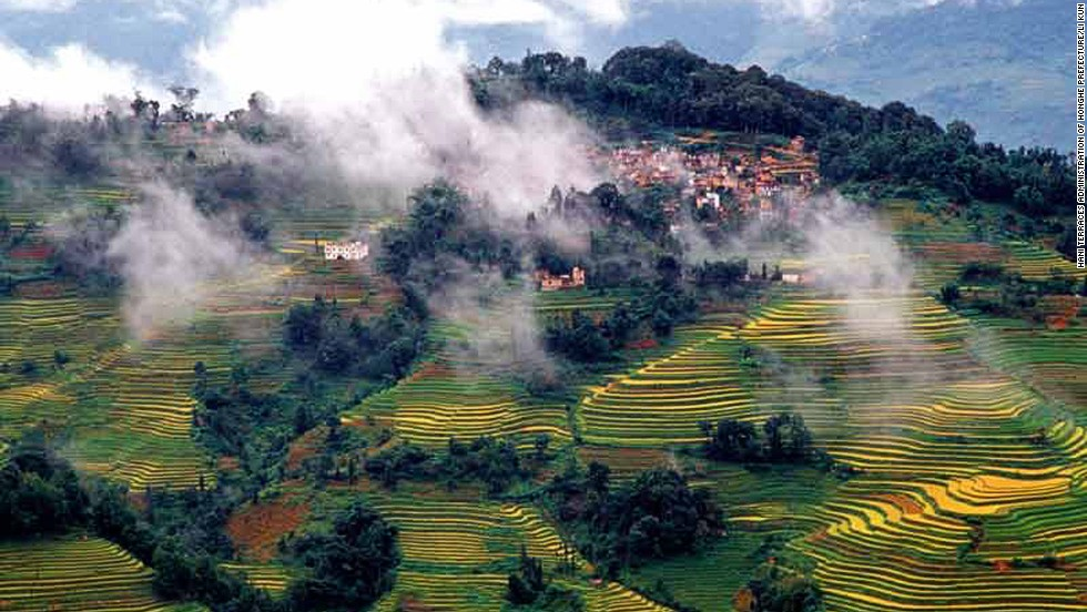 "A 16,603-hectare site in Southern Yunnan, the Honghe Hani rice terraces stretch from the slopes of the Ailao Mountains to the banks of the Hong River. ""Over the past 1,300 years, the Hani people have developed a complex system of channels to bring water from the forested mountaintops to the terraces,"" says UNESCO's Honghe Hani inscription. <br />"