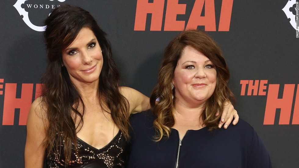 """The Heat"" co-stars Sandra Bullock and Melissa McCarthy embrace at the film's premiere in New York on June 23."