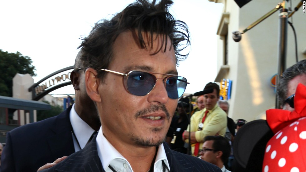 "Johnny Depp greets fans at the Los Angeles premiere of ""The Lone Ranger"" on June 23."