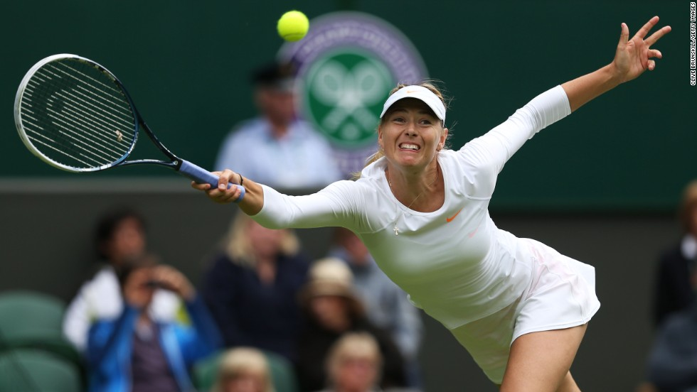 Maria Sharapova of Russia stretches for a forehand during her first-round match against Kristina Mladenovic of France on June 24. Sharapova won 7-6 (7-5), 6-3.