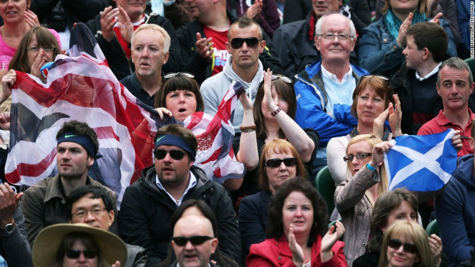 Fans cheer for Andy Murray of Great Britain during his first-round match against Benjamin Becker of Germany on June 24.