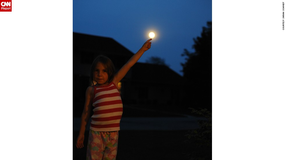 "<a href=""http://ireport.cnn.com/docs/DOC-994716"">Sarah Schmidt</a> captured her daughter Katelyn in an E.T.-inspired pose in Neenah, Wisconsin."