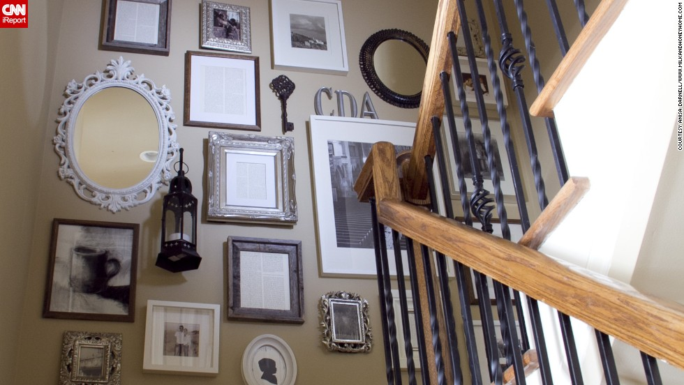"<a href=""http://ireport.cnn.com/docs/DOC-991000"">Anisa Darnell's</a> Roswell, Georgia, home came with a huge blank wall along the staircase. She filled it with a collage that is a tribute to her family."