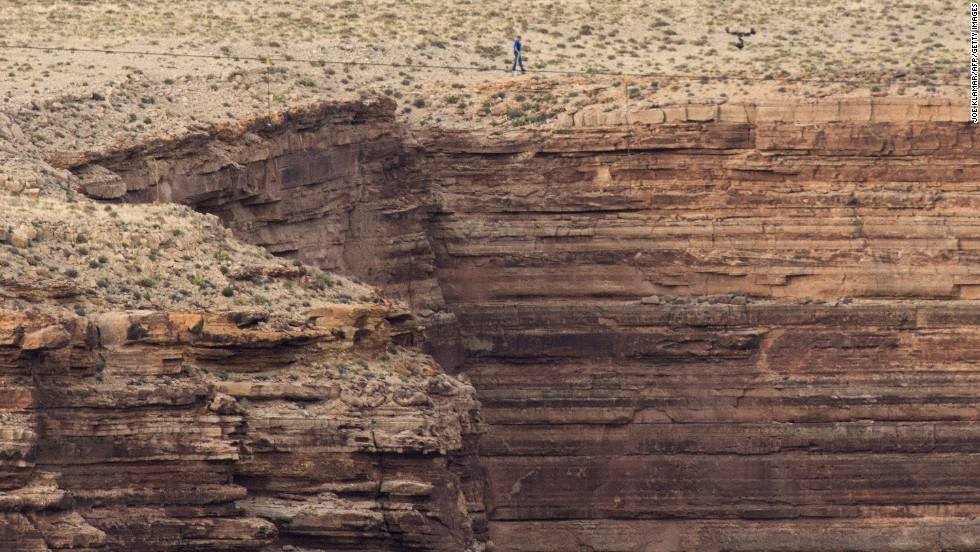 """Nik Wallenda walks on a tightrope 1,500 feet above a river near the Grand Canyon in Arizona on Sunday, June 23. <a href=""""http://www.cnn.com/2013/06/24/us/arizona-high-wire-wallenda/index.html"""">The quarter-mile trek</a> over the Little Colorado River Gorge took 22 minutes and 54 seconds."""