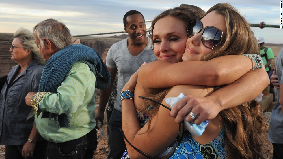 "Wallenda's wife, Erendira, center, hugs his sister Lijana Hernandez, following the tightrope performer's historic walk in Arizona on June 23. <a href=""http://www.cnn.com/2012/06/13/us/gallery/wallendas/index.html"">View photos of the Wallenda family through the years</a>."