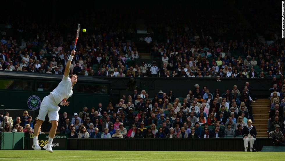 Britain's Andy Murray serves against Germany's Benjamin Becker during their first-round match on the first day of the Wimbledon Lawn Tennis Championships in London on Monday, June 24.