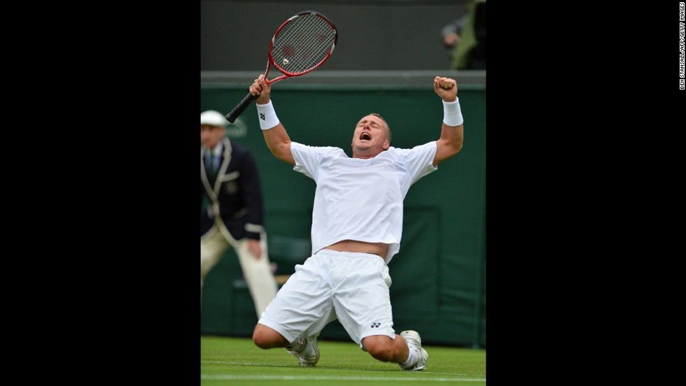 Australia's Lleyton Hewitt celebrates beating Switzerland's Stanislas Wawrinka on June 24.