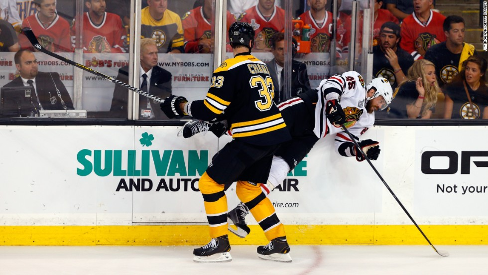 Boston's Zdeno Chara checks Chicago's Viktor Stalberg.