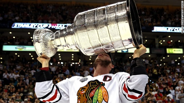 Jonathan Toews of the Chicago Blackhawks kisses the Stanley Cup after defeating the Boston Bruins 3-2 in the NHL Stanley Cup Final in Boston on Monday, June 24, 2013.