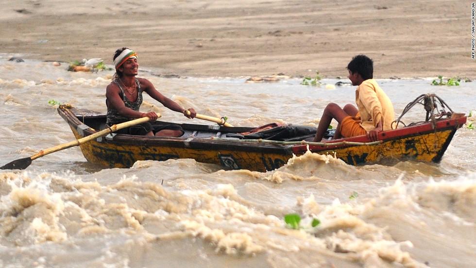 Boatmen navigate a fast-moving river in Allahabad, Uttar Pradesh state, on June 24.