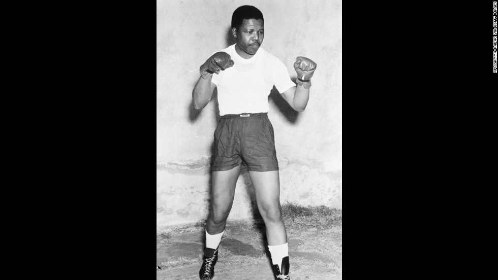 Mandela poses in boxing gloves in 1952.