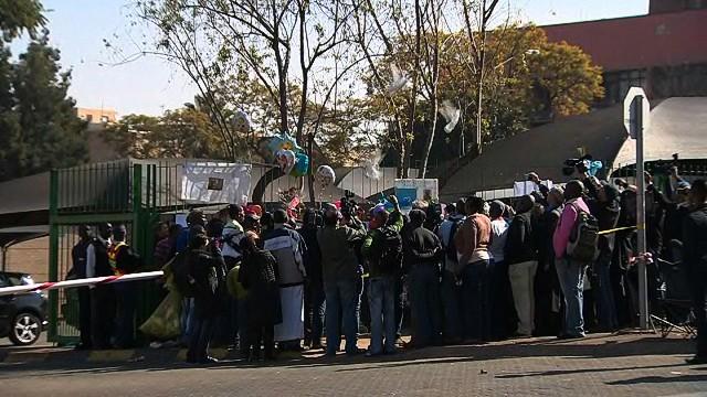 Dozens gather to pray for Nelson Mandela