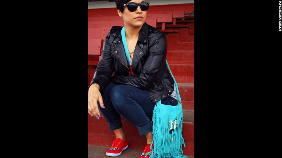 "Candace Halcro is an accessories designer from the Plains Cree/Metis tribe. She is skilled in Native American beading and <a href=""http://www.etsy.com/people/brownbeadedcom"" target=""_blank"">specializes in sunglasses</a>. Halcro will be applying her beading craft to Paul Frank sunglasses for the collection. She's seen here wearing beaded shoes, a purse and sunglasses that she created."