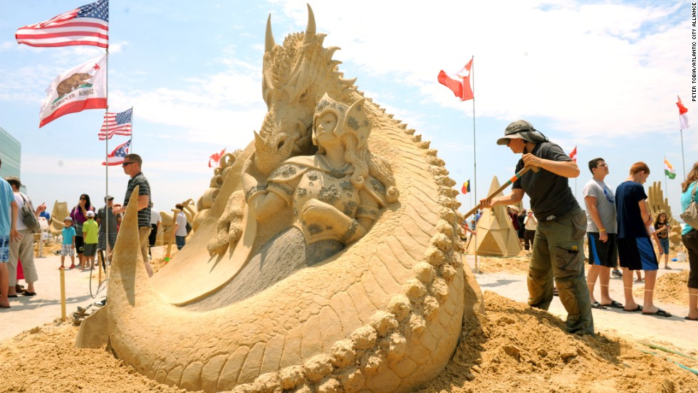 "Karen Fralich of Ontario, Canada, tends to her 1st place sculpture in the singles division at the 2013 <a href=""http://www.worldchampionshipofsandsculpting.com/"" target=""_blank"">World Championship of Sand Sculpting</a> in Atlantic City, New Jersey. It's titled, ""Amazon's Pet."" Click through the gallery for more amazing sand sculptures."