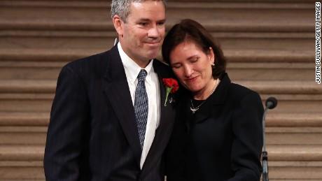 Anne Stevens Sullivan and Tom Stevens, siblings to former Ambassador Christopher Stevens, embrace during a memorial service for Stevens at San Francisco City Hall on October 16, 2012 in San Francisco, California.